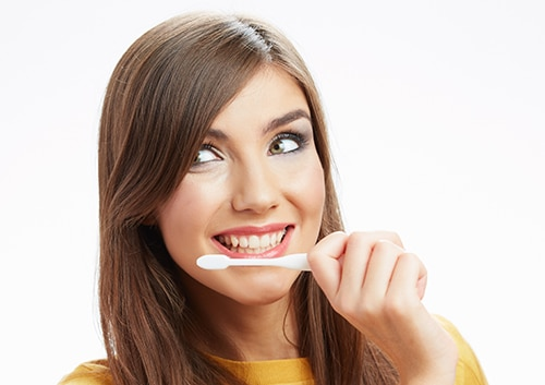 Smiling with a Tooth Brush John A Gerling DDS MSD McAllen TX